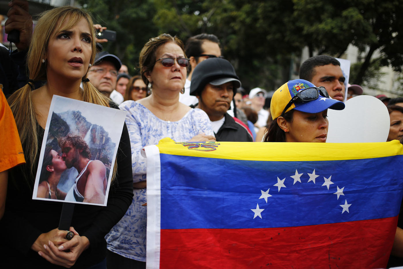 Supporters of former Miss Venezuela Monica Spear take part in a demonstration against violence in Caracas