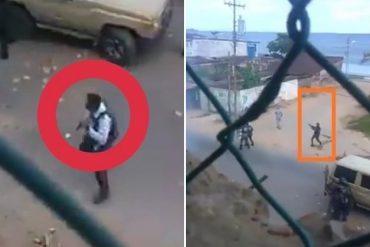 ¡REPRESIÓN! Captan a un funcionario de la GNB cuando saca su arma y dispara para dispersar protesta en Playa Grande este #28Sep (+Video)